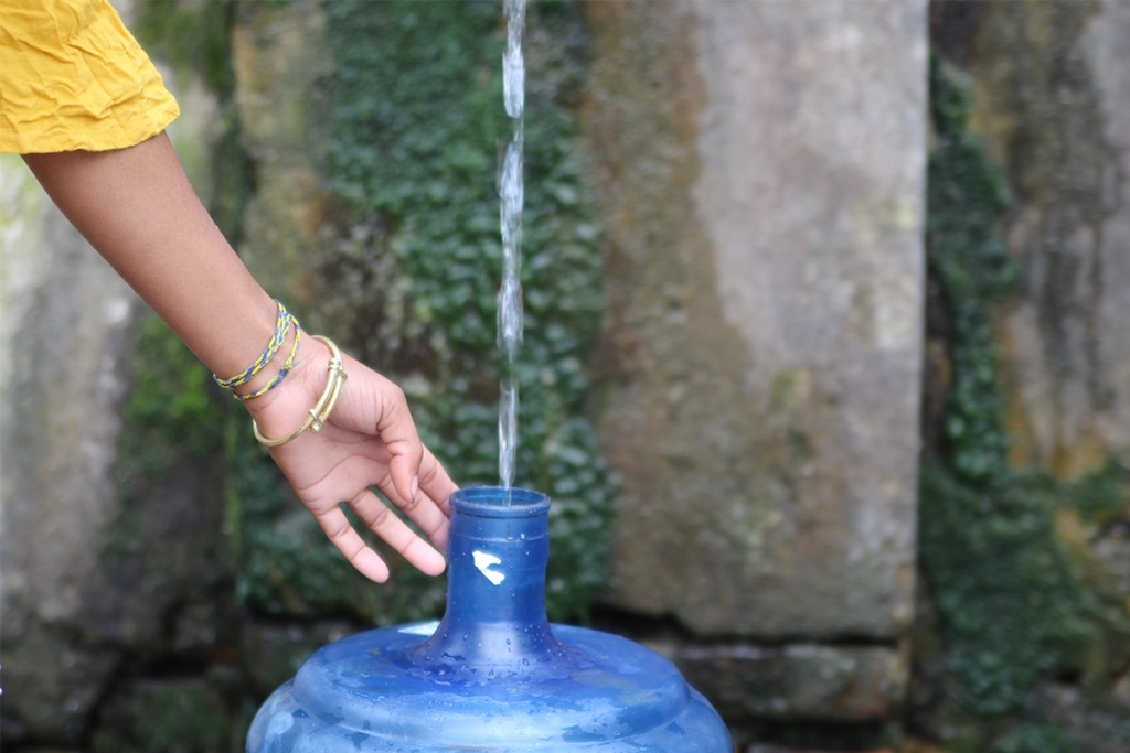 A young girl places her water jar along the water spout in Bhaisepati. (Image: Aawaaj News)